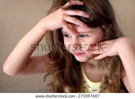 Sad Little Girl feel Headache in the Room - stock photo
