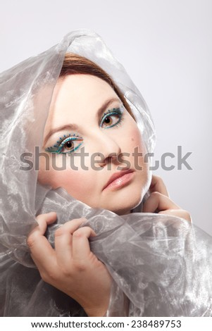 Sad look of a veiled woman with elaborate make-up - stock photo