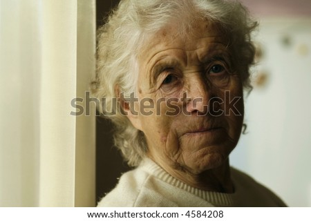 sad looking old lady - stock photo