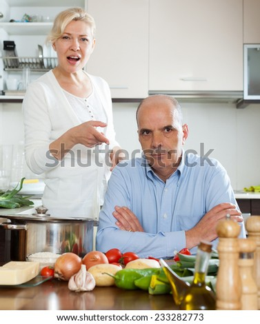 Sad  man and  woman during quarrel  in kitchen at home - stock photo