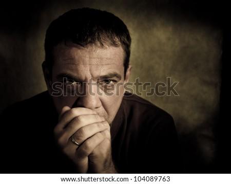 Sad man. Dark key - stock photo
