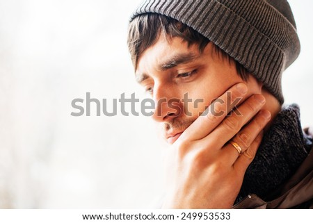 sad man in a hat - stock photo
