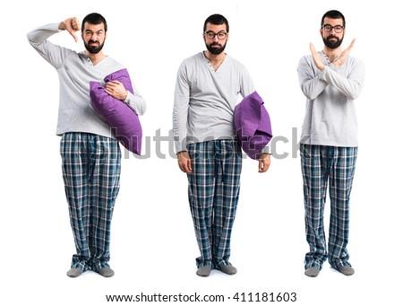 Sad man in pajamas - stock photo