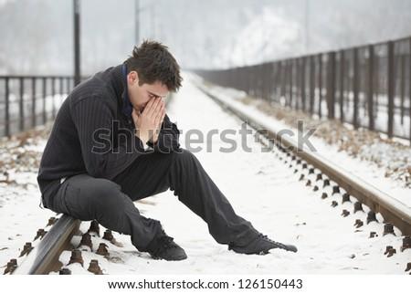 Sad Alone Man On Railway Platform Images & Pictures - Becuo