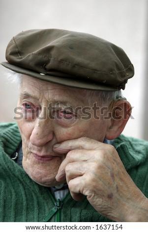 Sad old man - stock photo