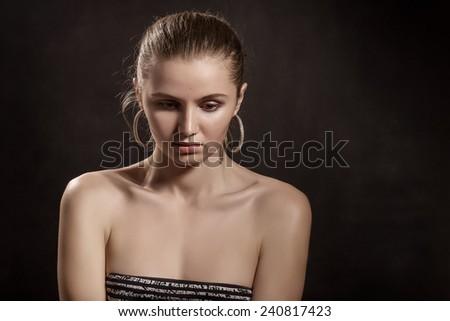 sad pensive girl portrait on black background - stock photo