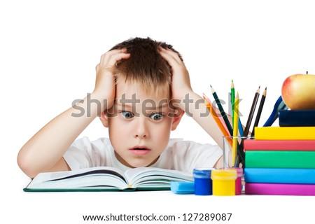 sad schoolboy doing is homework. isolated - stock photo