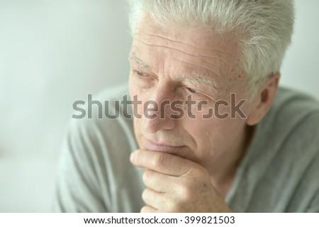 Sad senior man at home - stock photo
