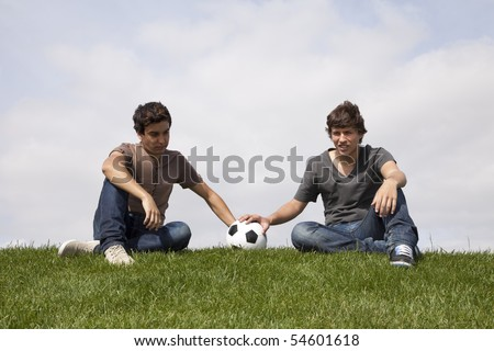 Sad soccer fans after their team lost in a match - stock photo
