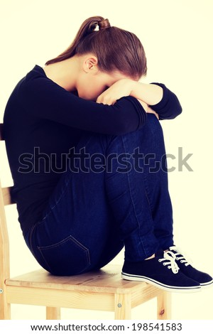 Sad teen girl heaving depression. - stock photo