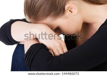 Sad teen girl heaving depression. Isolated on white - stock photo