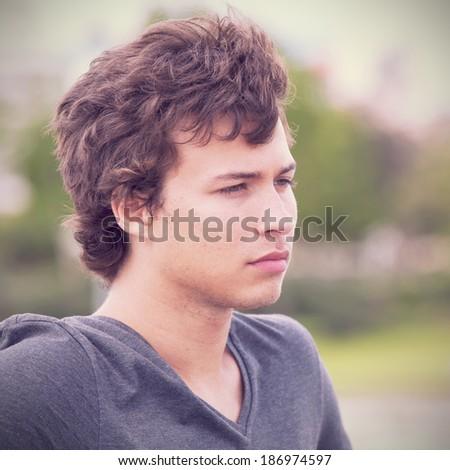 sad teenager looking away in outdoor - stock photo
