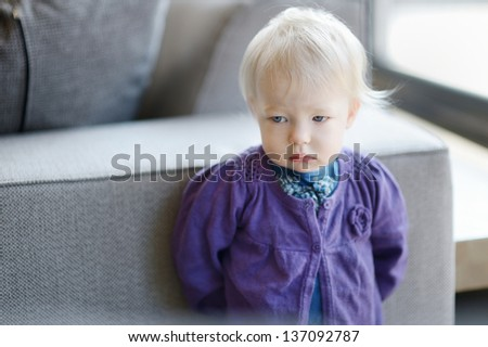 Sad toddler girl portrait indoors - stock photo