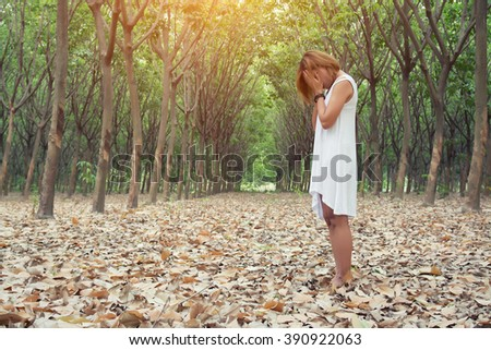 sad unhappy woman in the green forest, stress, depression - stock photo
