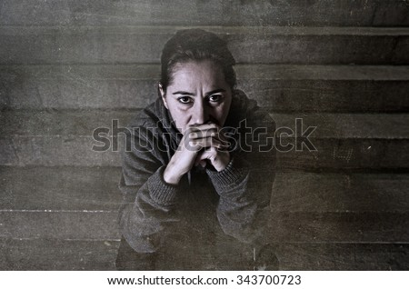 sad woman alone on street suffering depression looking desperate and helpless sitting lonely in dirty dark urban night background in female victim of abuse concept grunge dirty edit grunge dirty edit - stock photo