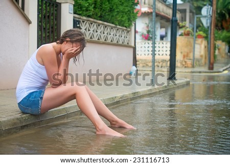 Sad woman crying on the street. - stock photo