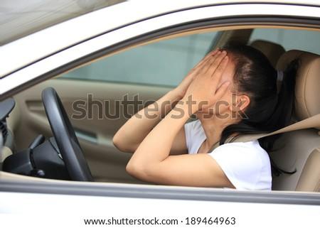 sad woman driver in car  - stock photo