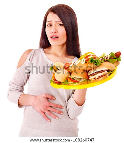 Sad woman get abdomen pain after eating fatty food. Isolated. - stock photo