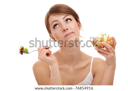Sad woman on diet with vegetables. Isolated on white background. - stock photo