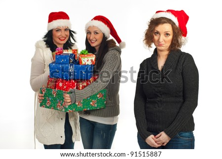Sad woman standing alone without presents while her friends smiling and holding many Christmas presents  isolated on white background - stock photo
