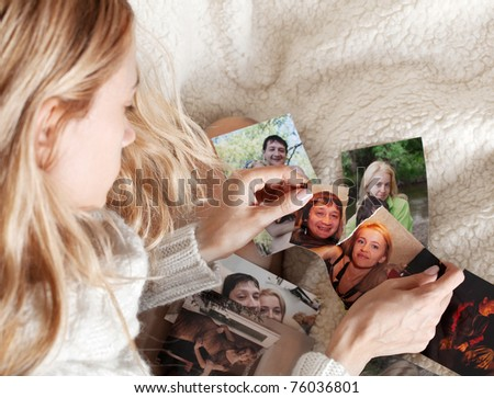 Sad woman, tearing a family photo - stock photo