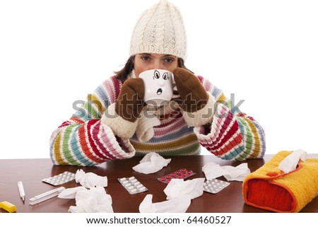 sad woman with flu symptom holding a mug with a hot drink (isolated on white) - stock photo