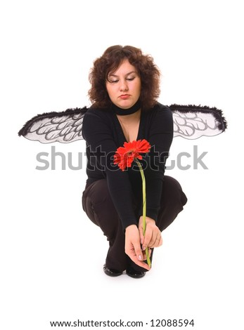 sad woman with wings looking at red flower - stock photo
