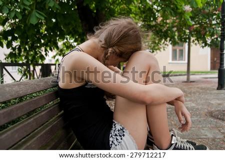 sad women on bench - stock photo