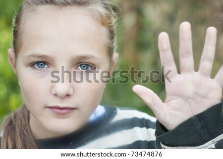 Sad young girl feels lonely. - stock photo