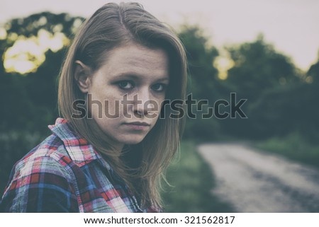 Sad young teenager girl - stock photo