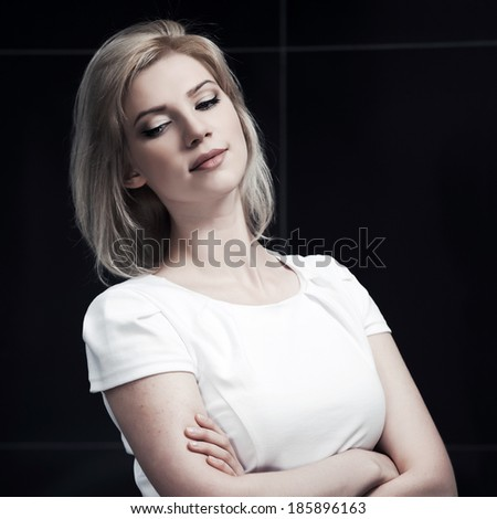 Sad young woman looking down - stock photo