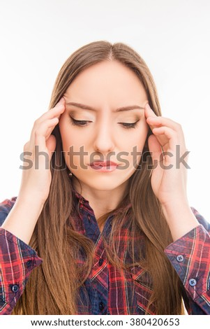 sad young  woman  suffering from headache and touching her temple - stock photo
