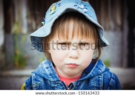 Saddened by the child against the wall. - stock photo