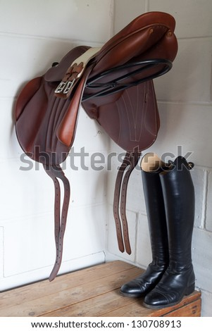 saddle and riding boots - stock photo