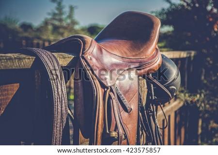 Saddle with stirrups - stock photo