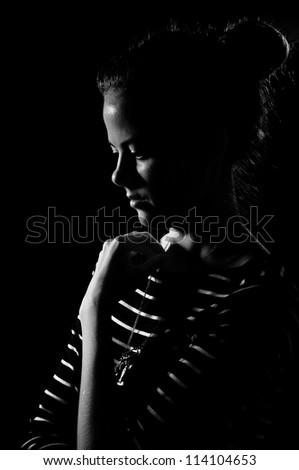 sadness girl on black background, black and white image - stock photo