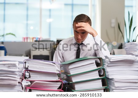 Sadness manager have so many paperwork in the office - stock photo