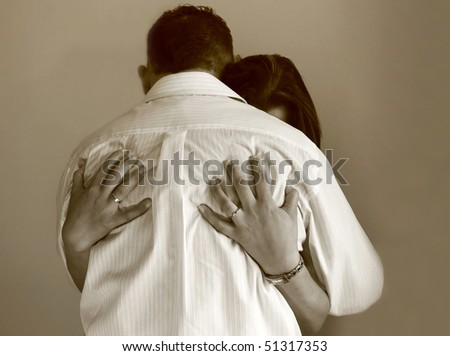 Sadness woman in mans arms - stock photo