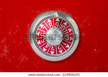Safe dial in red with numbers - stock photo