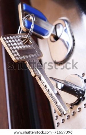 Safe door. Key in a keyhole. opening - stock photo