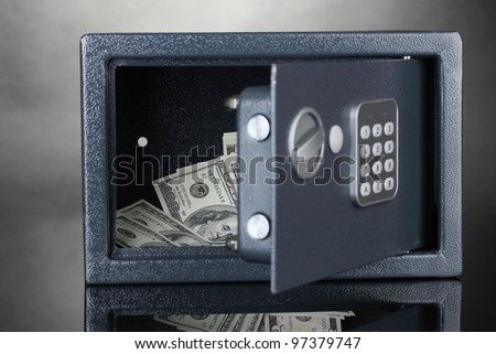 safe with dollars on grey background - stock photo