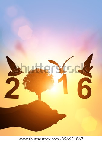 "Safe world Concept with bird and Two Hand holding young plant  silhouette in "" 2016 "" text on pastel sky background. Happy new year 2016 - stock photo"