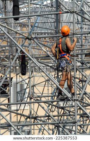 Safety at work. Workers on the scaffolding - stock photo