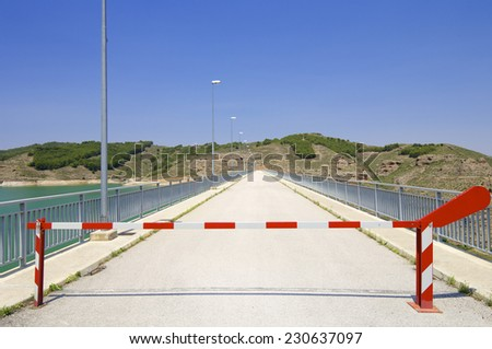 Safety barrier at a dam production of electrical energy. - stock photo