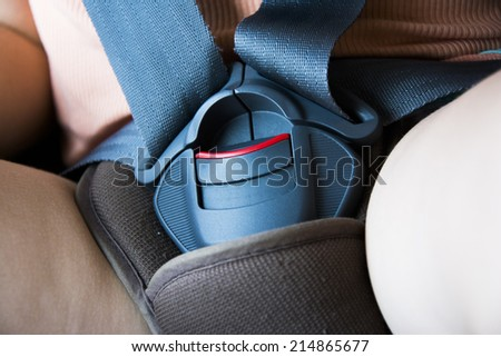 Safety belt in car seat locked for journey in a car with a kid - stock photo