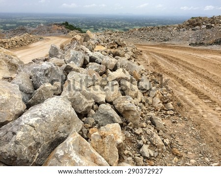 Safety bunker along the transportation road in mining  - stock photo