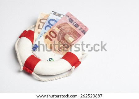 safety buoy with euro banknotes on a white background. financial concept for currency risk or protection  - stock photo