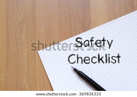 Safety checklist text concept write on notebook with pen - stock photo