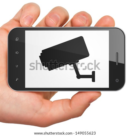 Safety concept: hand holding smartphone with Cctv Camera on display. Generic mobile smart phone in hand on White background. - stock photo