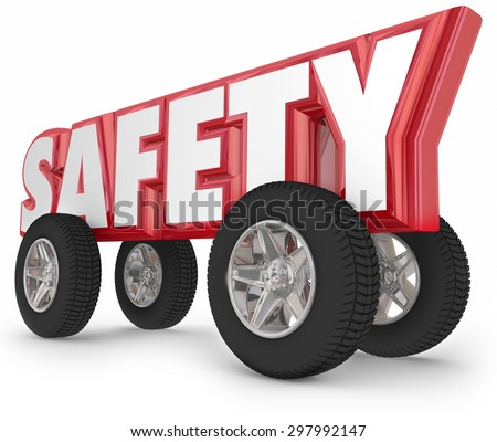Safety driving word with wheels or tires to illustrate safe traveling in car, automobile, truck or other vehicle on the road - stock photo